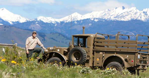 Dr. Johnson stands in front of his restored 1953 Dodge M37 military truck.